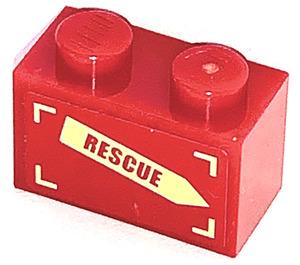 LEGO Brick 1 x 2 with 'RESCUE' on Yellow Arrow (Left) Sticker (3004)