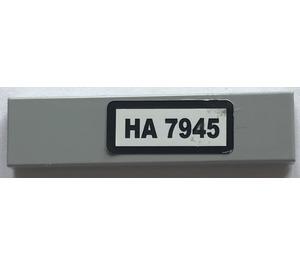 "LEGO Medium Stone Gray Tile 1 x 4 with ""HA 7945"" Sticker"