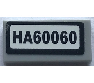 "LEGO Tile 1 x 2 with ""HA60060"" Sticker (3069)"