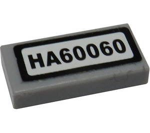 "LEGO Tile 1 x 2 with ""HA60060"" Sticker with Groove (3069)"