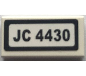 "LEGO Tile 1 x 2 with ""JC 4430"" Sticker with Groove (3069)"