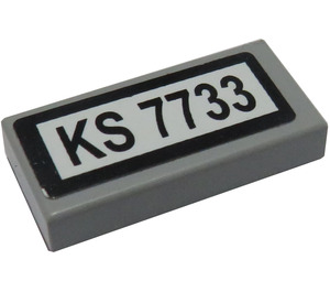 LEGO Tile 1 x 2 with 'KS 7733' Sticker with Groove (3069 / 15598)