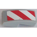 LEGO Slope Curved 1 x 2 x 0.66 with red and white danger stripes with red corners - Left Sticker (11477)