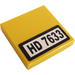 """LEGO Yellow Tile 2 x 2 with """"HD 7633"""" Sticker with Groove"""